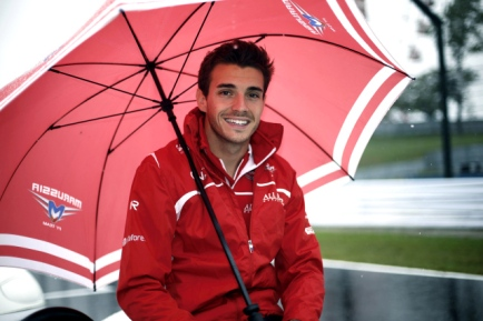 SUZUKA, JAPAN - OCTOBER 05: Jules Bianchi of France and Marussia shelters from the rain during the drivers parade prior to the Japanese Formula One Grand Prix at Suzuka Circuit on October 5, 2014 in Suzuka, Japan. (Photo by Jiri Krenek/isifa/Getty Images)
