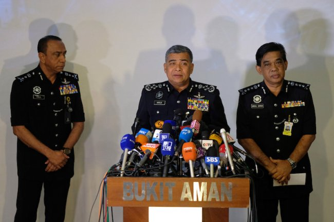 Malaysia's Royal Police Chief Khalid Abu Bakar (C) speaks during a news conference regarding the apparent assassination of Kim Jong Nam, the half-brother of the North Korean leader, at the Malaysian police headquarters in Kuala Lumpur